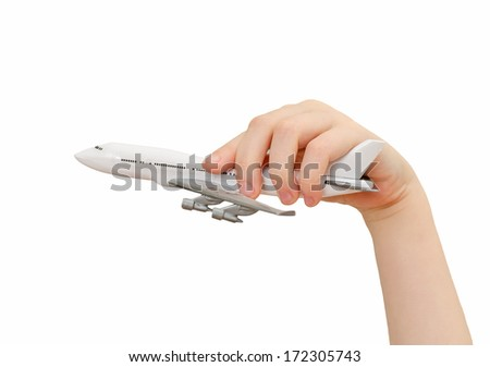 Child hand holding model airplane. Isolated on white. - stock photo