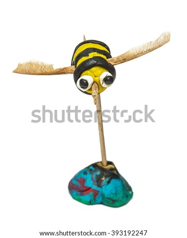 child hand made bee isolated on the white - stock photo