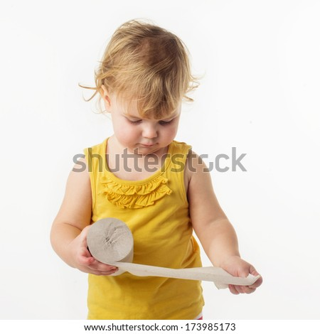 child hands holding toilet paper - stock photo