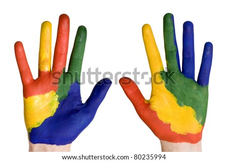 Child hands painted in colorful paints ready for hand prints. - stock photo