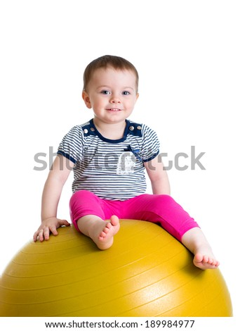 Child having fun with  fitball isolated - stock photo