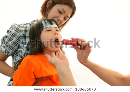 Child having physical examination - stock photo