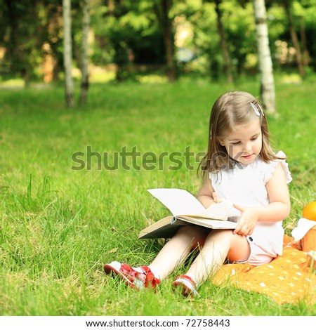 Child having picnic in summer park - stock photo