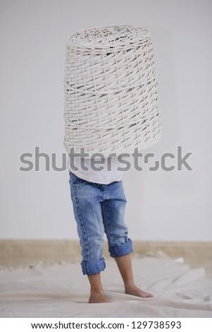 child hidden in a basket - stock photo