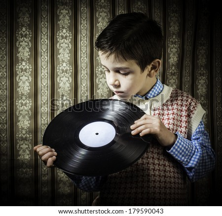 Child hold lp. Vontage clothes - stock photo