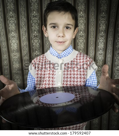 Child hold lp. Vontage clothes - stock photo