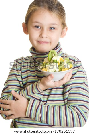 child holding a dessert of ice cream and fruit isolated on white background - stock photo