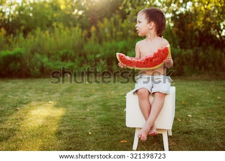 child holding a piece of watermelon - stock photo