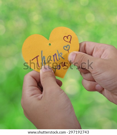 Child holding a thank you card   - stock photo