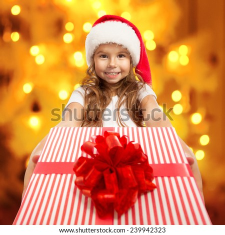 Child holding Christmas gift box in hand. Holidays, christmas, new year, x-mas concept. - stock photo