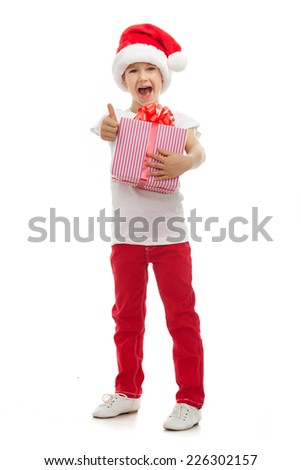 Child holding Christmas gift box in hand. Isolated on white background. Holidays, christmas, new year, x-mas concept. - stock photo