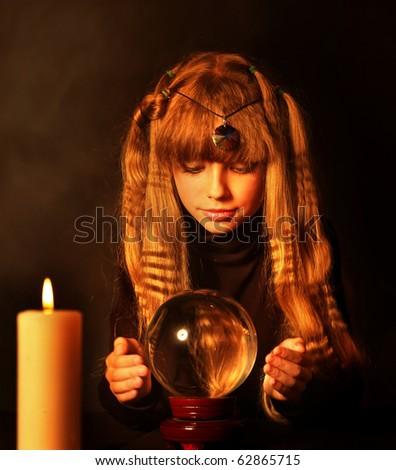 Child holding crystal ball. - stock photo