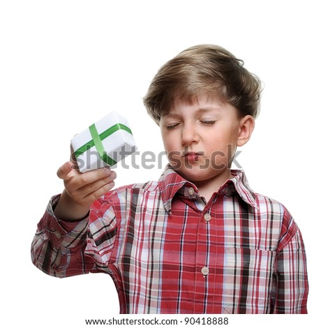 Child holding gift box in hand. Isolated on white background - stock photo