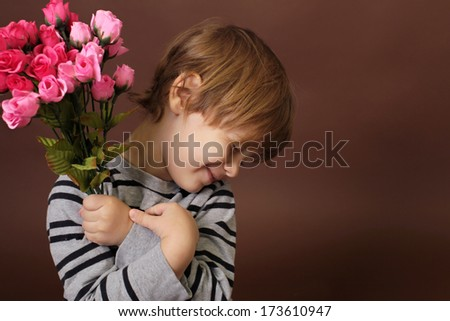Child holding Valentine's Day flowers, roses - stock photo