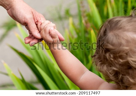 child holds for finger moms - stock photo