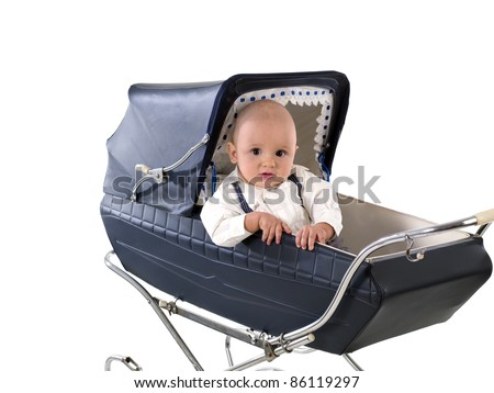 child in a baby carriage/pram blue vintage years 60/70 - stock photo