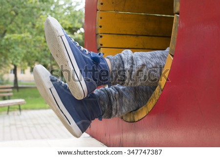 Child in a tunnel at playground - stock photo