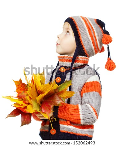 Child in autumn leaves. Maple fall over white - stock photo