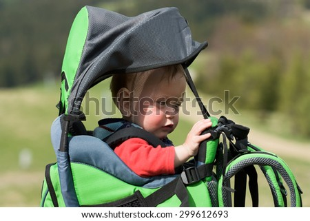 Child in Baby Hiking Carrier - stock photo