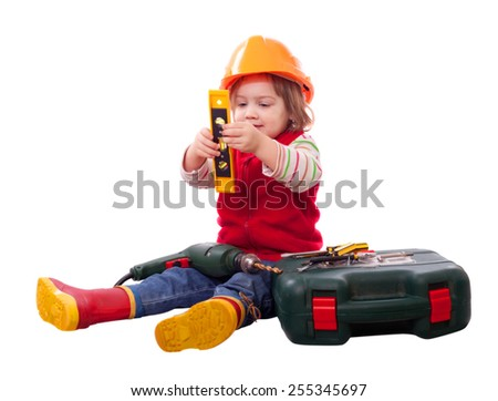Child in builder hardhat with tools. Isolated over white background   - stock photo