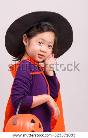 Child in Fancy Costume on White / Child in Fancy Costume / Child in Fancy Costume, Studio Shot - stock photo