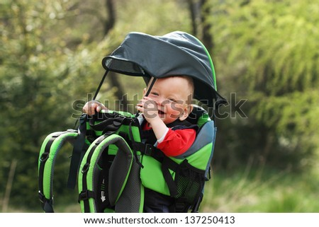 Child in Hiking Baby Carrier - stock photo