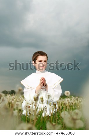 child in his first holy communion, praying hands, purity soul - stock photo
