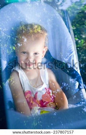 Child in the car in his baby chair - stock photo