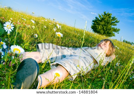 child in the meadow - stock photo