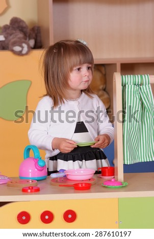 Child in the nursery is playing in cooking - stock photo
