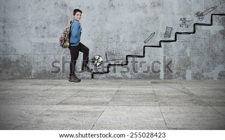 child in the scale of education - stock photo
