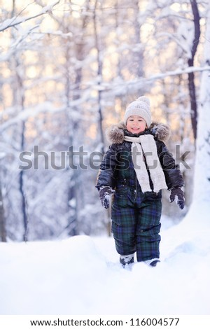 child in the winter forest, a lot of snow - stock photo