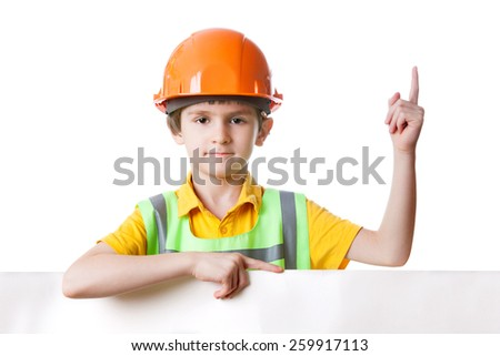 Child in work clothes with billboard, isolated on white background. His finger up - stock photo