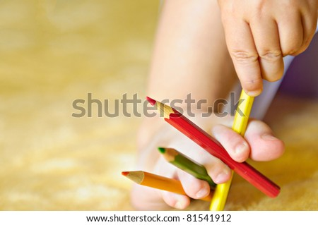 Child is playing with pencils - stock photo