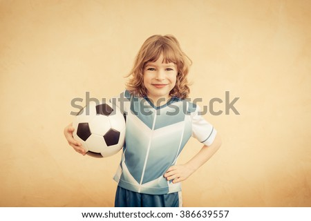 Child is pretending to be a soccer player. Success and winner concept - stock photo