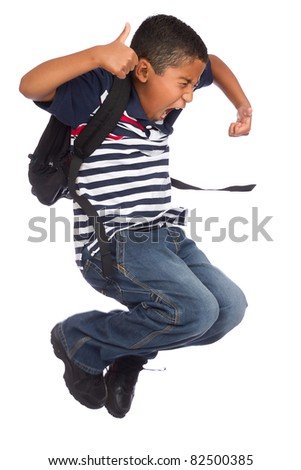 Child Jumping of Joy Because He is Going Back to School - stock photo
