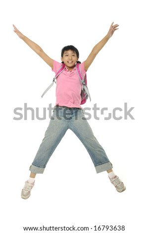 child jumping with backpack, back to school - stock photo