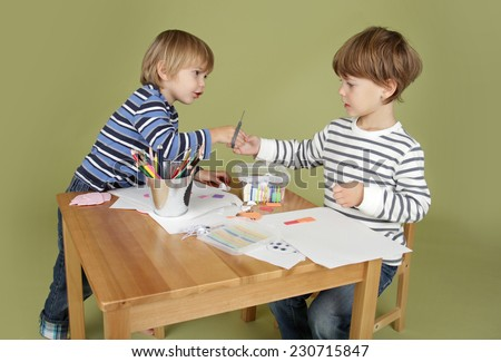 Child, kid engaged in arts and crafts activity, sharing and learning concept - stock photo