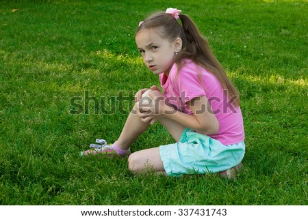 Child knee with an adhesive bandage and bruise - stock photo