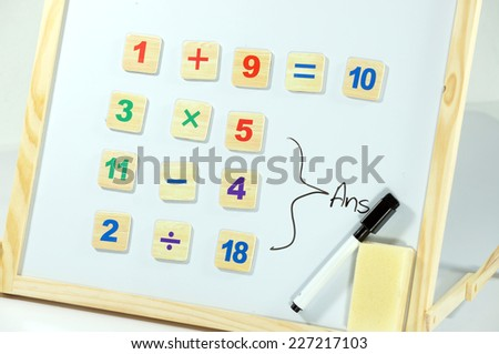 Child Learning On whiteboard - stock photo