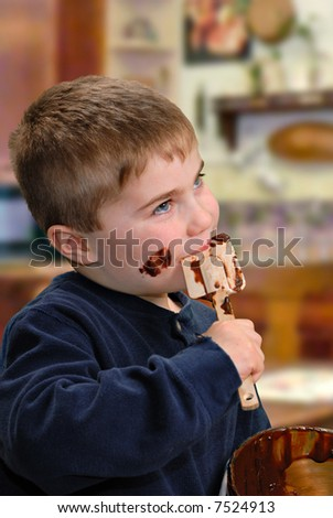 Child licking chocolate batter off spatula - stock photo