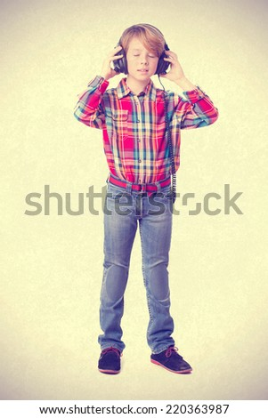 Child listening music with an headphones - stock photo