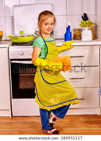 Child little girl  cleaning  home kitchen. Housekeeping. - stock photo