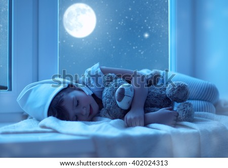 child little girl  sleeping at the window dreaming and admiring the starry sky at bedtime night - stock photo