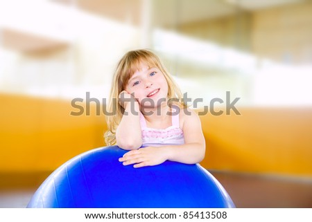 child little girl with gym aerobics ball relaxed - stock photo