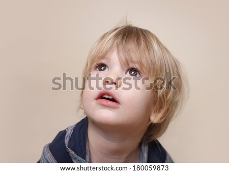 Child looking up, curiosity, close up face portrait - stock photo