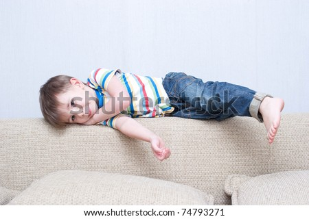 child lying on the couch - stock photo