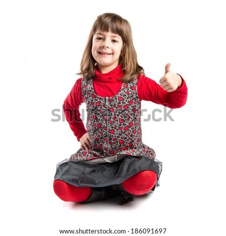 Child making Ok sign over white background  - stock photo
