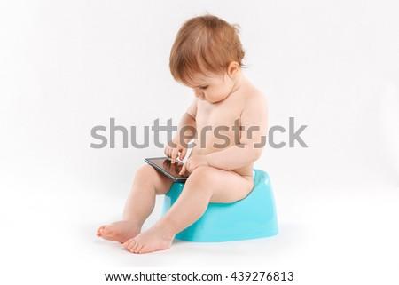 child on a pot on a white background - stock photo