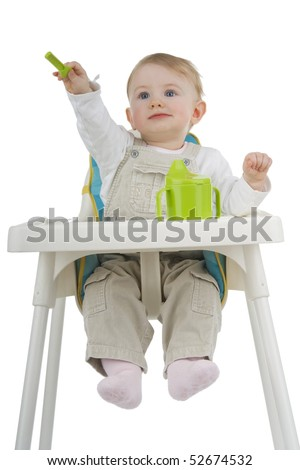 Child on child's stool with potty and teaspoon on white background. - stock photo